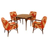 A Custom Game Table with Four Arm Chairs designed by Paul Laszlo