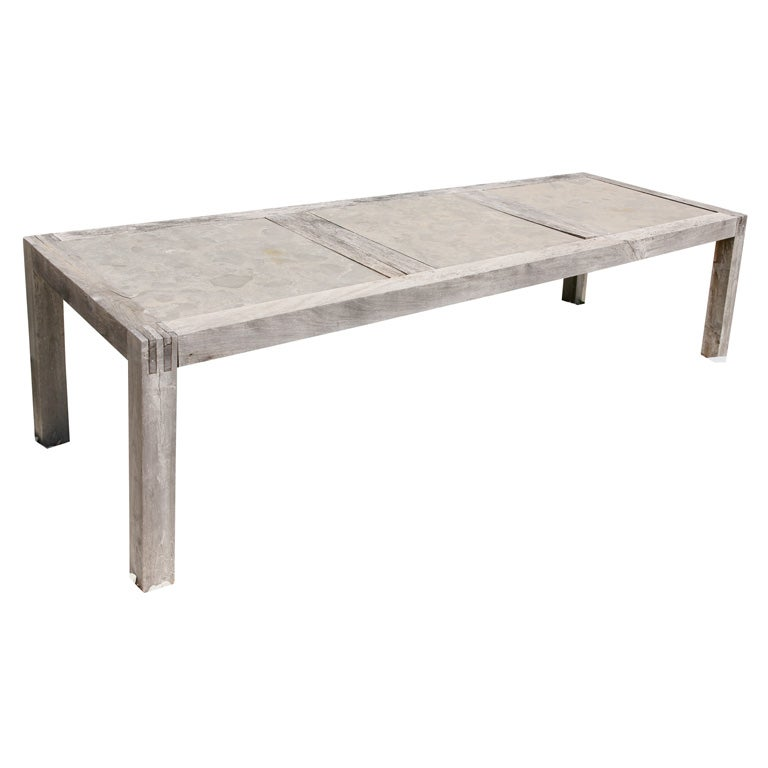 this indoor outdoor stone and teak dinging table is no longer