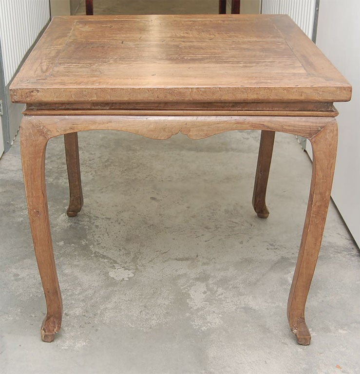 Early 19th century Qing dynasty Shanxi game table with curved apron.