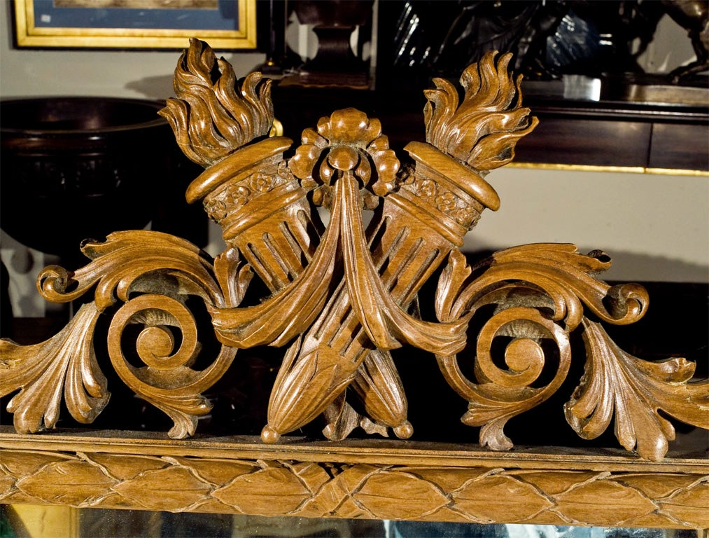 hand carved fruitwood mirror in the transitional Roccoco to Neo-Classic style. deeply carved with  wonderful detail