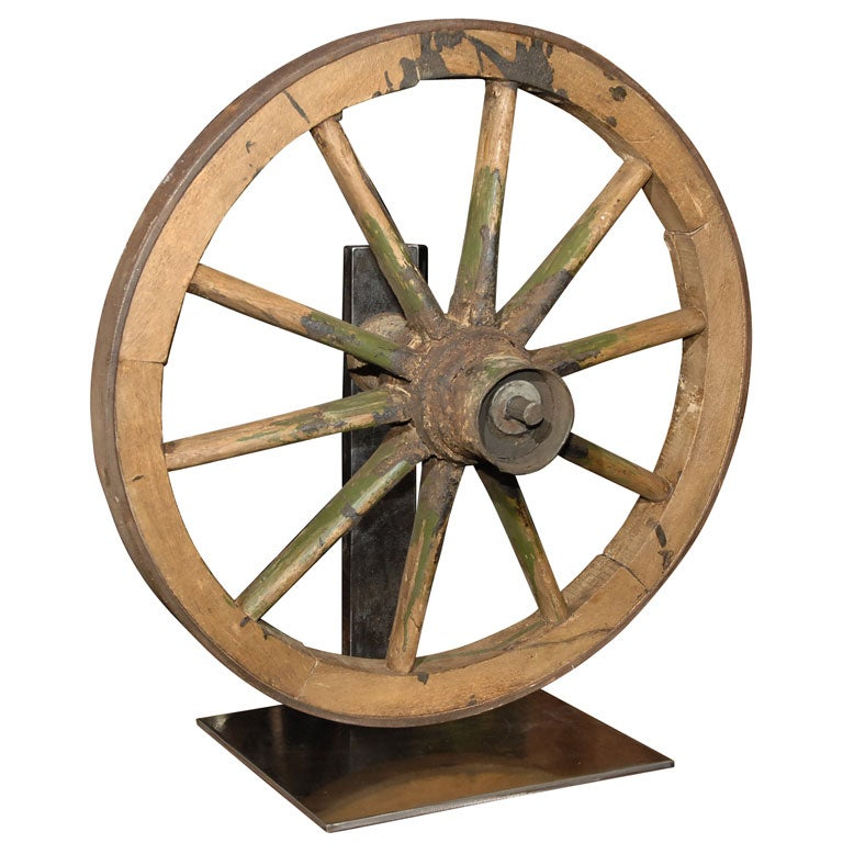 Antique wagon wheel on brushed steel stand for Things to do with old wagon wheels