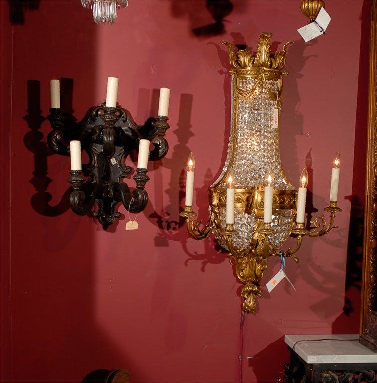 #CW2311, very elegant pair of gilt bronze and crystal wall sconces having five lighted arms and five internal lights each.