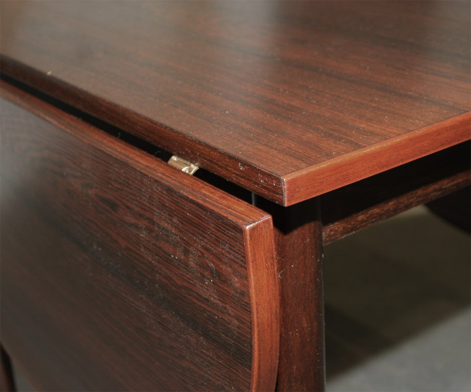 Narrow rosewood oval dining table at 1stdibs