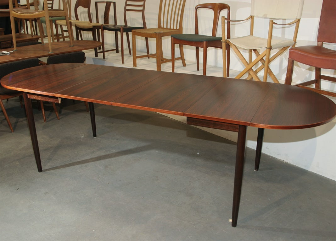 Narrow rosewood oval dining table at 1stdibs for Dining room tables 1940s