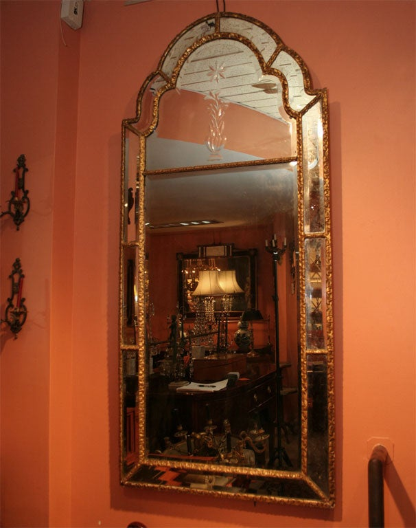 Fine large Queen Ann carved giltwood mirror with beveled glass.