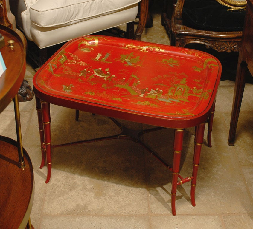 19TH C. RED CHINOISERIE TRAY TABLE<br /> AN ATLANTA RESOURCE FOR FINE ANTIQUES<br /> WE HAVE A VERY LARGE INVENTORY ON OUR WEBSITE<br /> TO VISIT GO TO WWW.PARCMONCEAU.COM