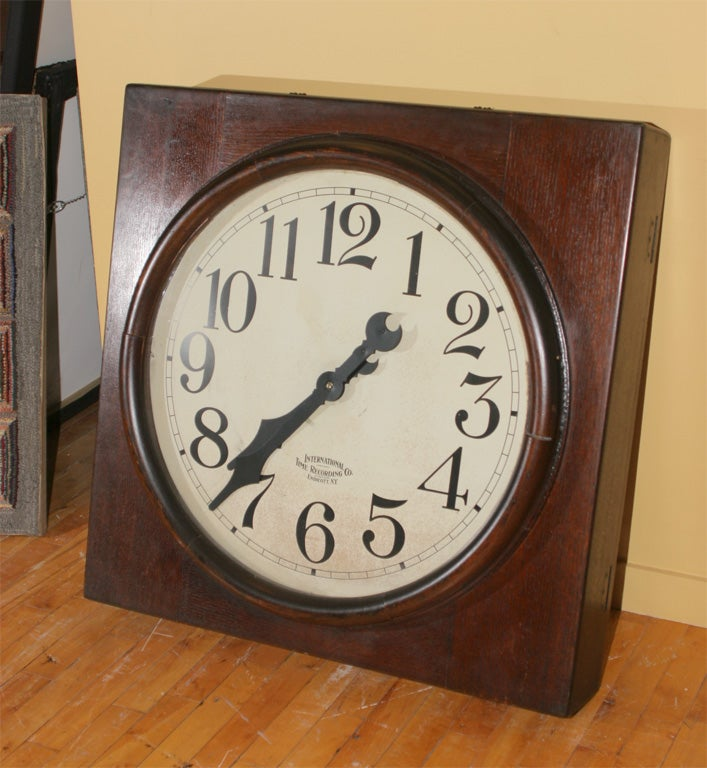 Imposing oak encased clock with bold black numerals and hands, and logo of the maker, International Time Recording Company of New York.  Endicott, N.Y.  The International Time Recording Company (ITR) began as the Bundy Manufacturing Company in