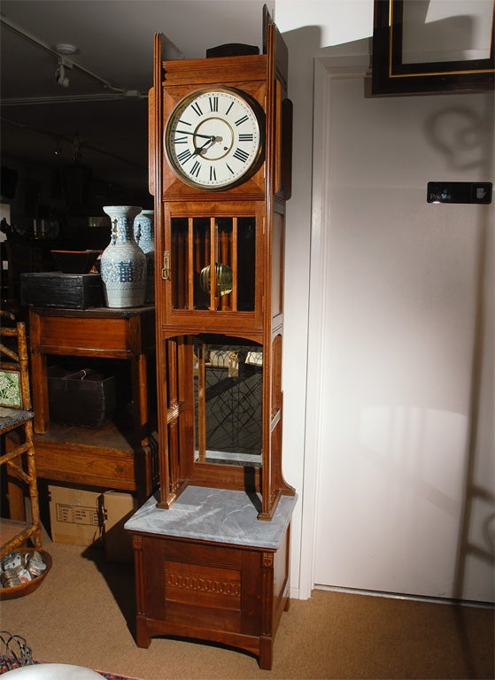 This very nice American Grandfather clock would be well suited for that special place in an arts and crafts setting as well as a delight just about anywhere else. The case is superbly crafted in walnut with fine details. The dial and movement have
