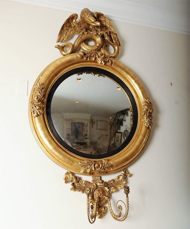 Gilt English Federal Style Dutch Convex Mirror with Eagle and Serpent decorated pediment.