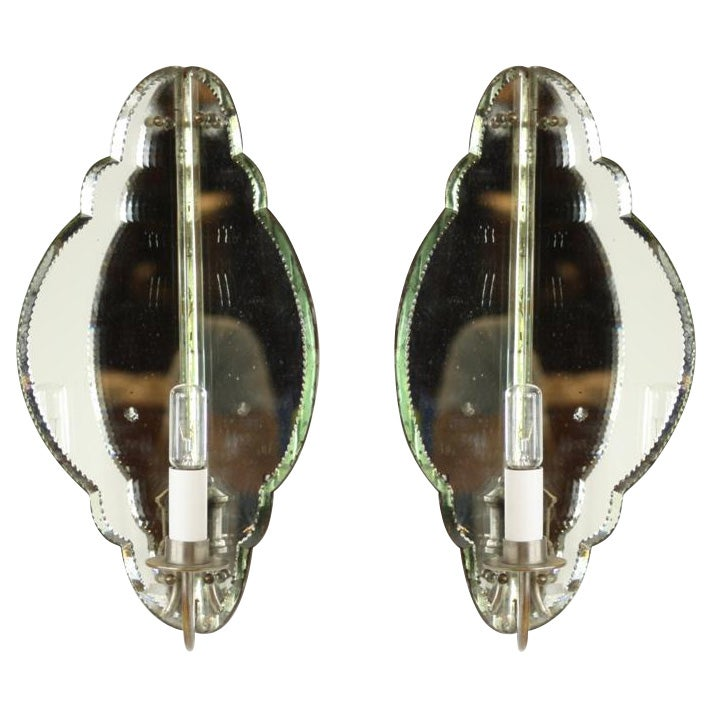 An unusual pair of 1940s French mirrored corner sconces with shaped glass panels. Recently rewired.