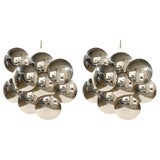 Pair of Large Scale Sculptural Chrome Sconces by Reggiani