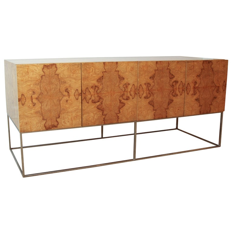 A Milo Baughman Olive Wood and Chrome Sideboard. at 1stdibs