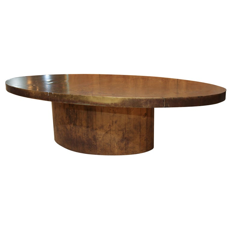 An oval painted copper covered coffee table at 1stdibs for Oval copper coffee table
