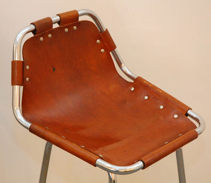 Original Charlotte Perriand barstool  designed for Les Arcs ski lodge.   Great patina to  leather and original chrome base.