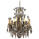 Antique French crystal and bronze 18-light chandelier.