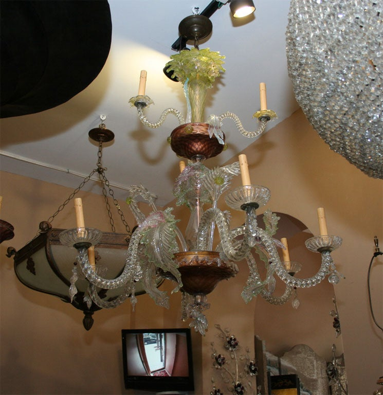 A, circa 1920 Venetian glass chandelier with two tiers foliage motif decorative elements.