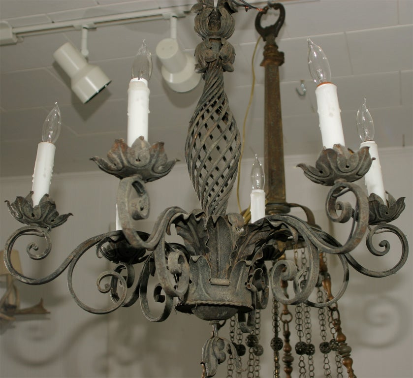 Six armed hand-forged iron chandelier.