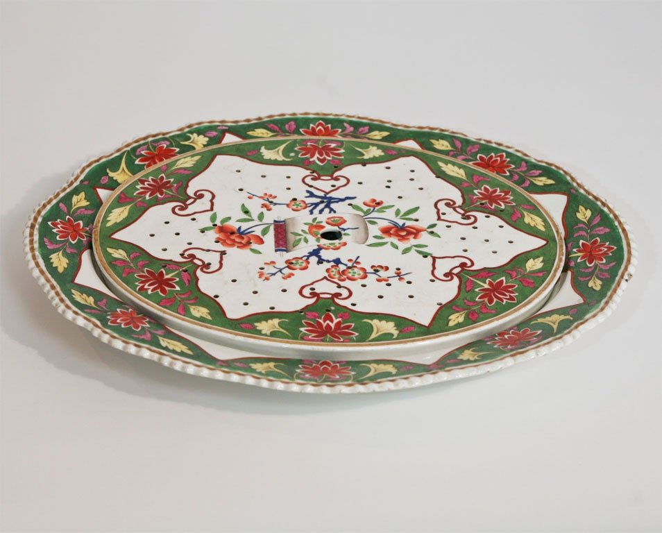 Amazingly large meat platter with hand painted Chinoiserie-style   polychrome enamel decoration. Includes the matching strainer/drainer. Platter has a gadroon border and gold trim.