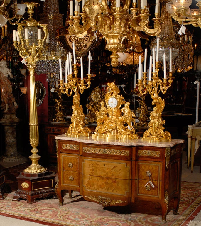 Opulent and exquisite 19th century French three piece garniture, with original gilt and magnificent chasing. Each candelabra is 35 inches high. The clock face is signed Clermont, Rue St Honore, Paris.