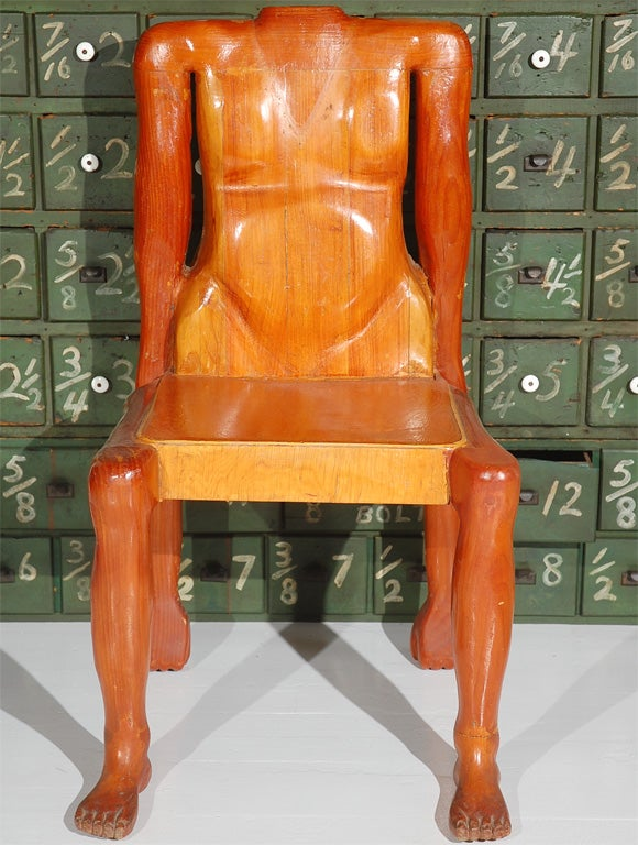 Have a seat! One of a kind human form chair. Wonderfully carved muscles, toes, clenched fists for support. Looks like the chair is ready to go crawling across the floor. Would look great on its own elevated pedestal. Found in Iowa. Chair is
