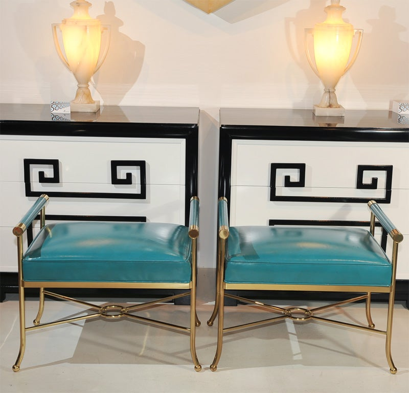 Pair of neoclassical style brass benches upholestered in original turqoise leather.