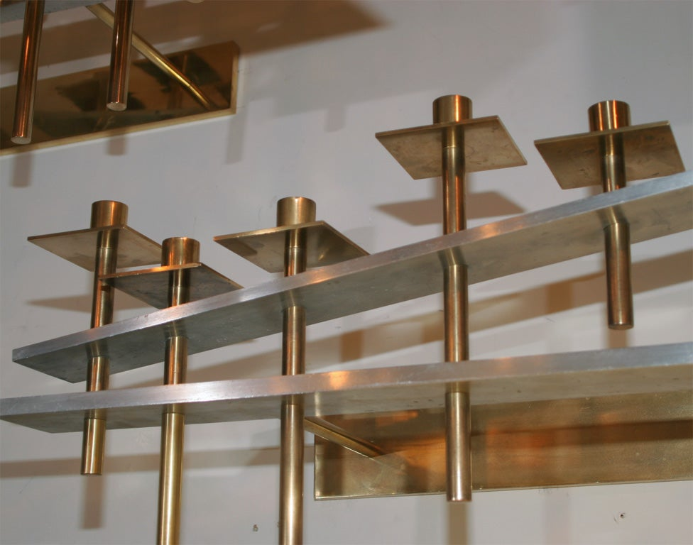 A pair of architectural wall-mounted candelabra.