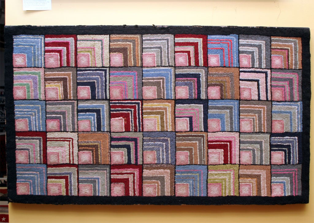 Handhooked rug in graphic design similar to Log Cabin quilt pattern. Small scaled, finely detailed.