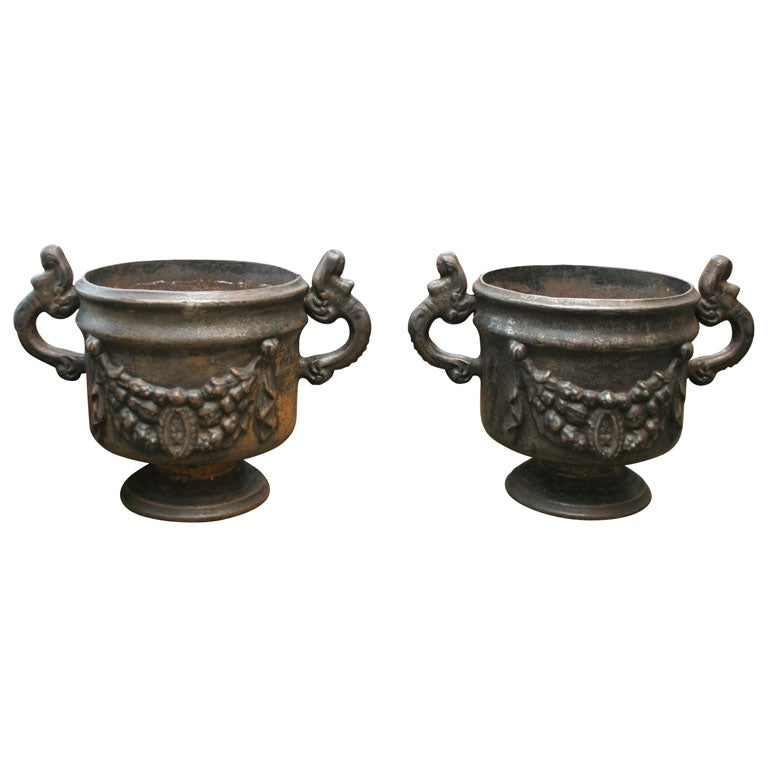 Pair of Ornate Cast Iron Urns For Sale