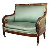 Antique French Louis Philippe settee. Mahogany and gold leaf