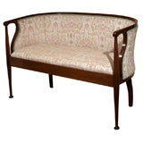 Antique English mahogany and upholstered settee.