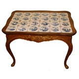 Swedish Rococo carved oak table with Dutch Delft tile