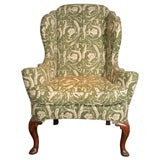 Queen Anne Carved Walnut Wing Chair. English, circa 1710