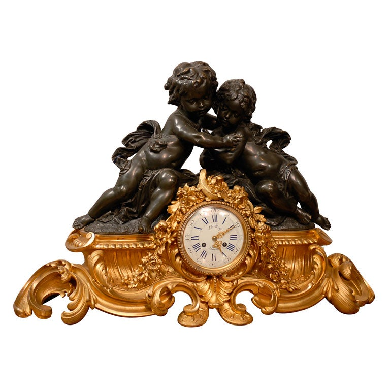 French Clock in Gilt and Patinated Bronze with Two Cherubs
