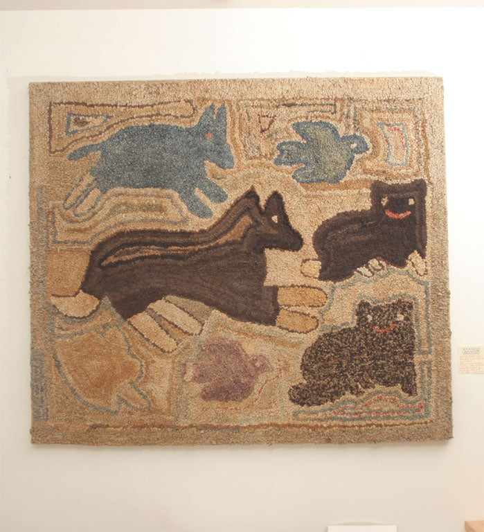 Primitive animals including a dog and cats with blue birds and possibly a blue rabbit in a flight of fantasy.  Exhibited at Museum of American Folk Art, New York.