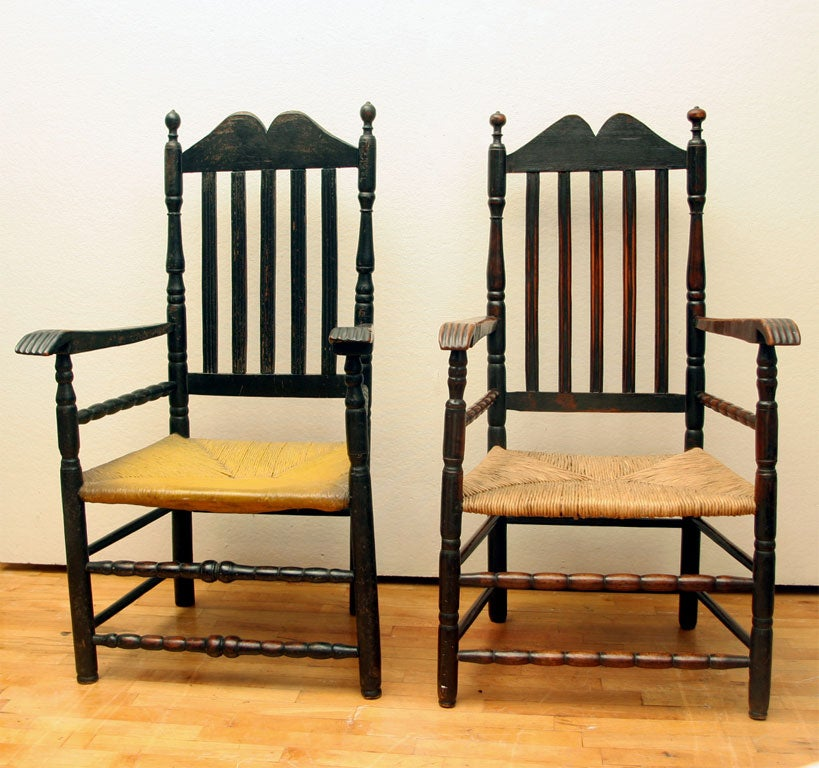 One of pair in original paint.  Second in old black paint over black with pieced feet and stretcher. Both with carved arms. Probably of Long Island or Connecticut shore origin, in the New York Dutch tradition.