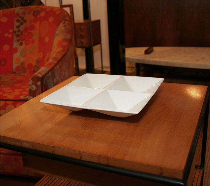 A geometric divided ceramic tabletop tray with glossy white glaze by Kaj Franck for Arabia. Finnish, circa 1960.