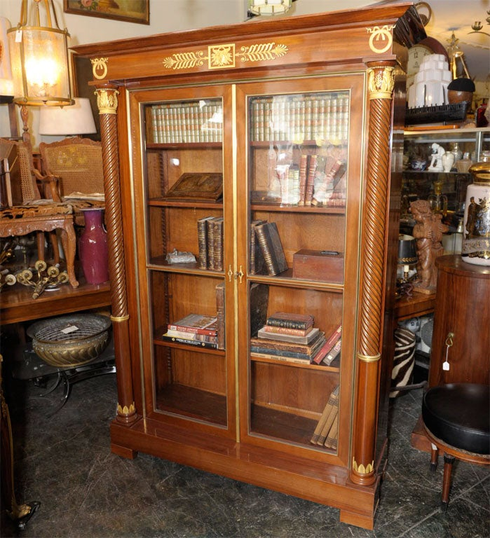 An exceptional French mahogany bookcase - bibliotheque with finely cast gilt bronze mounts and interior fitted with 4 shelves. Late 19th century with original key. Very Fine top quality workmanship.