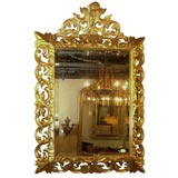 Antique French Louis XIV gold leaf rococco mirror.