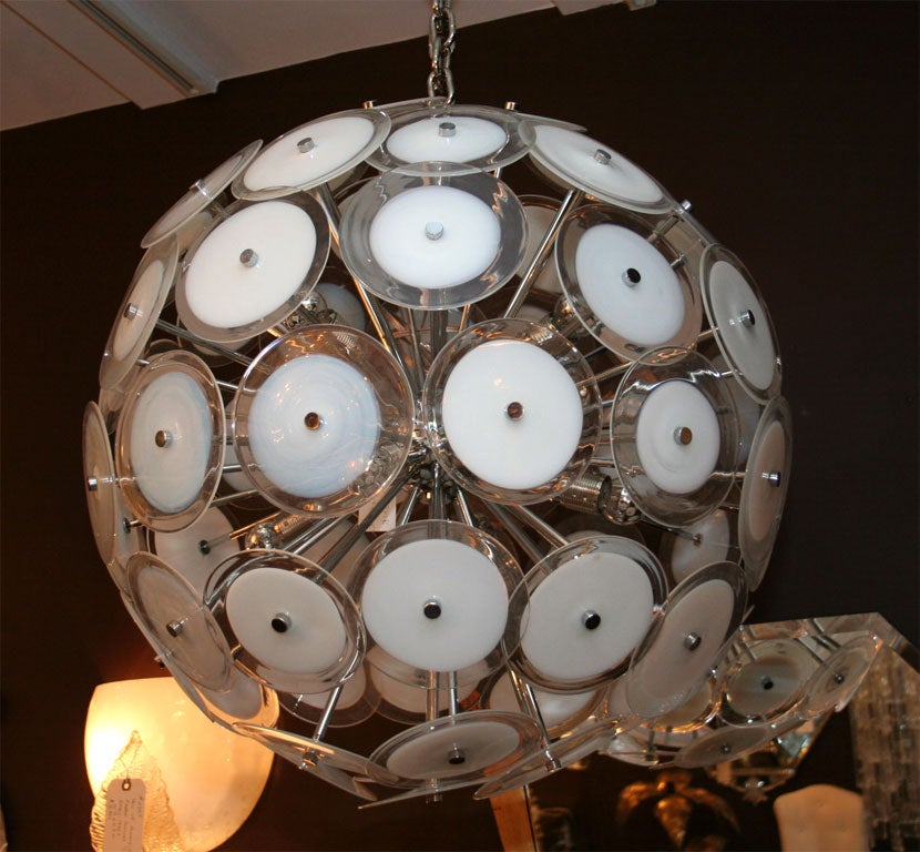 White disc Sputnik chandelier.