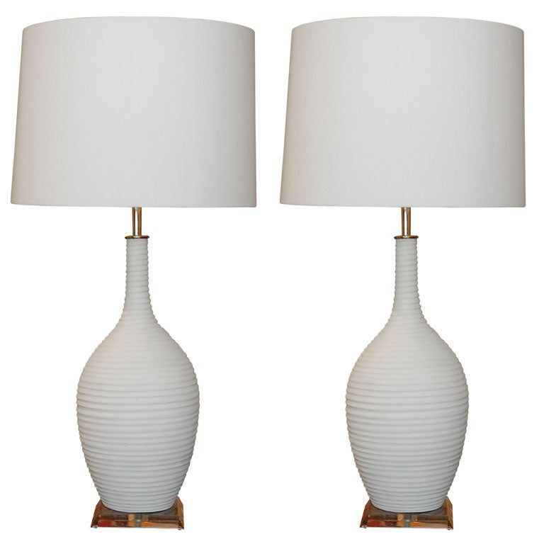 Pair Of White Ceramic Lamps With Lucite Base At 1stdibs