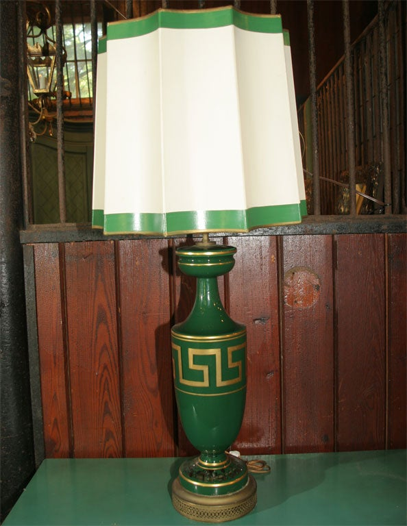 Reversed painted green glass lamp with Greek Key design with original heavy paper fluted shade. 17