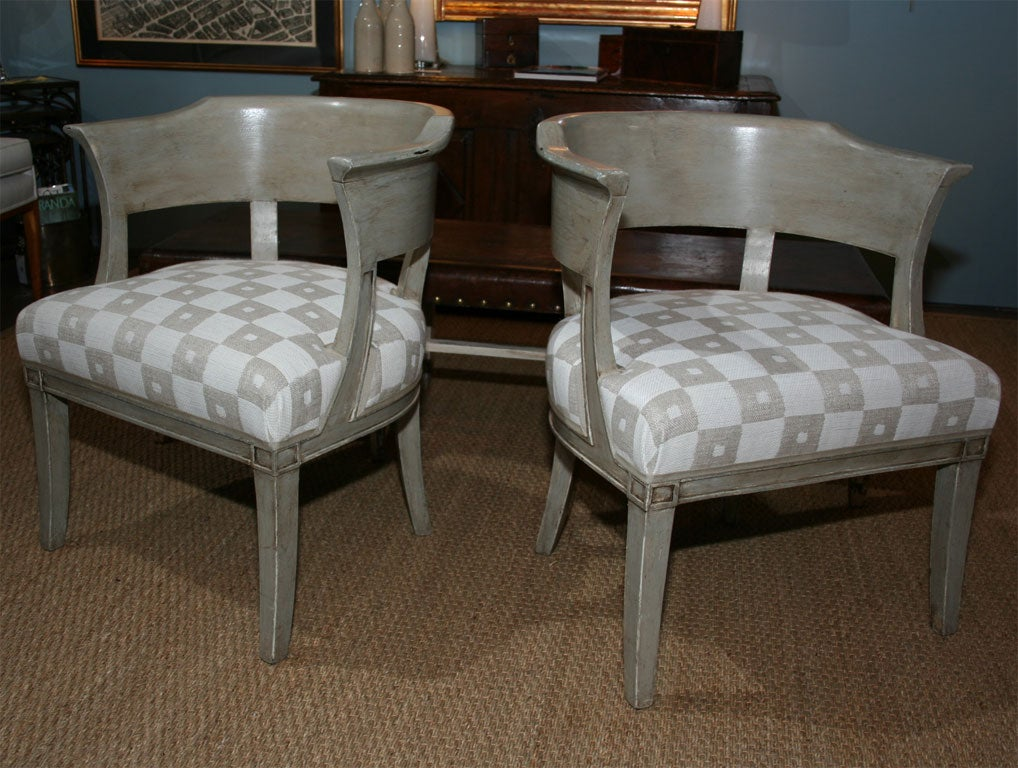 A pair of French painted armchairs with newly upholstered seats and curved, partially open back; from Eze sur Mer, southeast France.