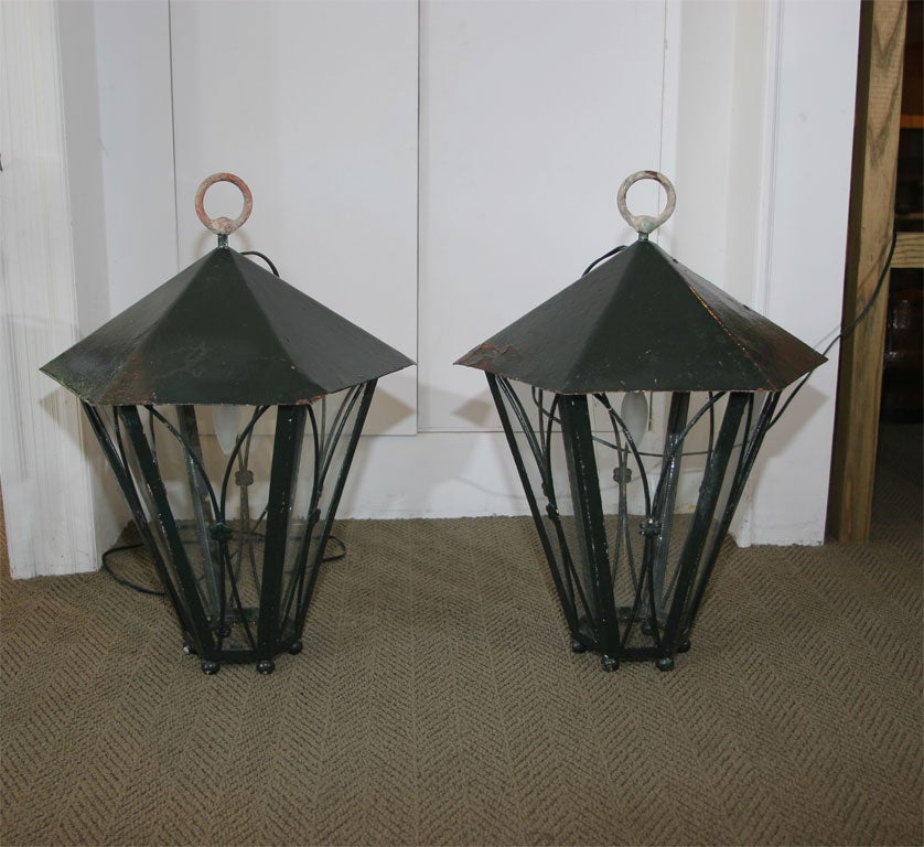 Provençal style electrified lanterns. Can be hung or used as tabletop lanterns.