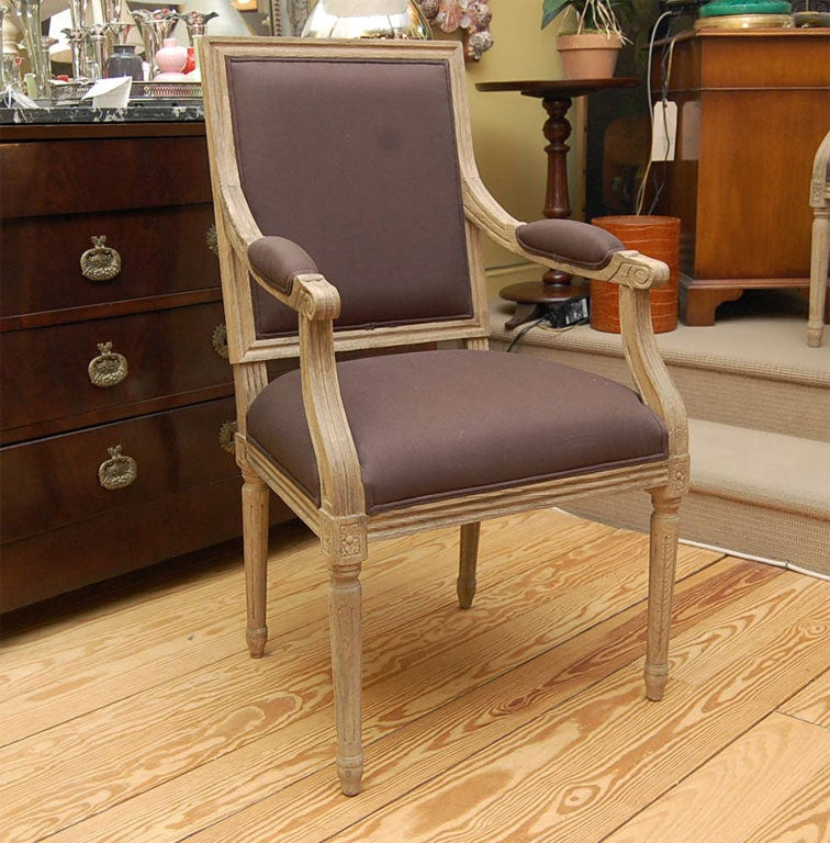 Elegant pickled oakwood armchair in a beautiful dark linen fabric. Handsome in any room at a dining table, cocktail table or positioned along side a chest in a hall.