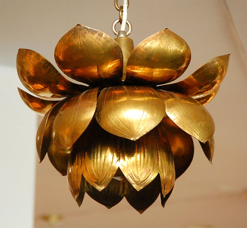 Sculptural brass chandelier in the shape of a lotus flower. Beautiful patina to the brass. Priced Individually.<br /> Professionally rewired.
