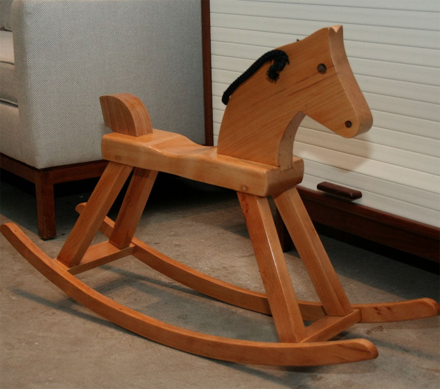 Original solid beech rocking horse by Kay Bojesen.  He is famous for his wooden animals and this rocking horse.