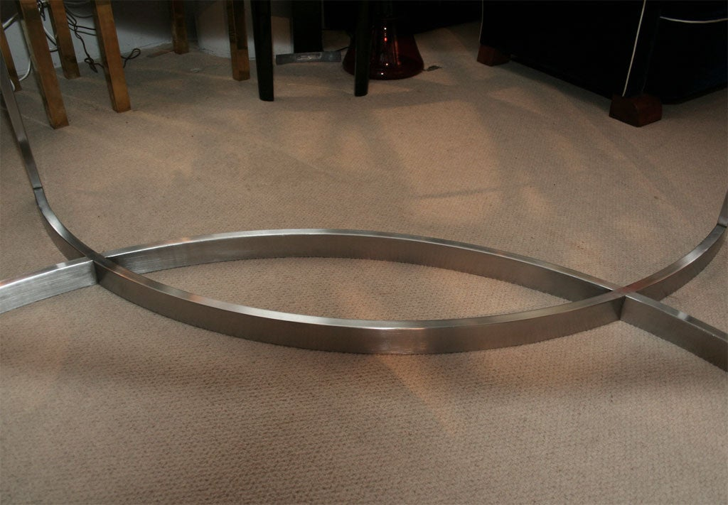 glass and stainless steel dining table by paul le geard