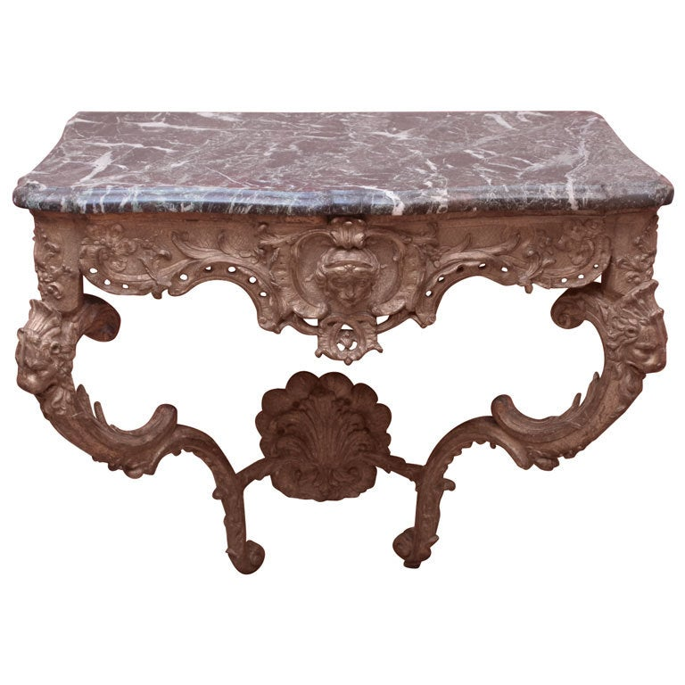 Carved and gilded wood and marble console table