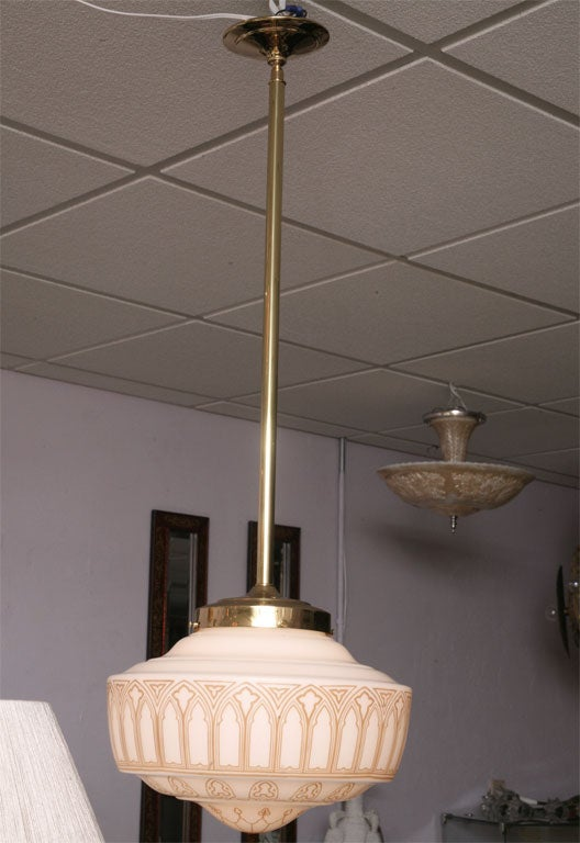Spectacular Art Deco pendant fully restored, metal is redipped in a matte brass color. This fixture will ad stature and elegance to any room. $4200 offer