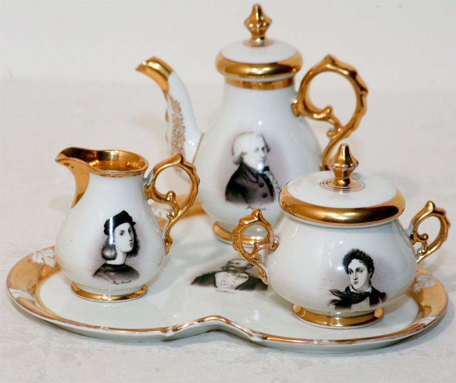 Diminutive porcelain tea set with hand-painted portraits depicting notable men of history including Mozart, Raphael, Humbolt, Byron and Saphir.
